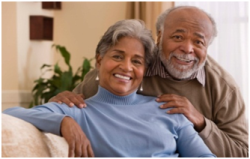 Senior Couple Smiling in Their Living Room